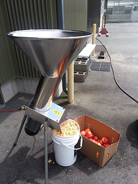 A portable cider press in action