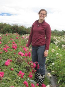 Garfinkel samples peonies in a field.