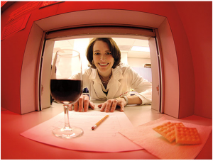 Scientist sliding a wine and survey through a window.