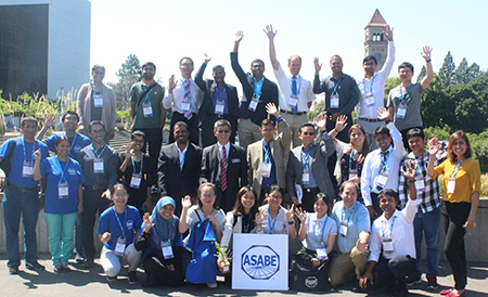 BSE students and faculty wave in a group photo at their society's annual conference.