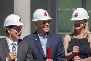 In hardhats, with shovels, Mark Schoesler, Mike LaPlant, and Mary Dye smile following the groundbreaking ceremony.