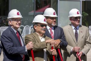 WSU and CAHNRS leaders in hardhats hold shovels during the groundbreaking ceremony.