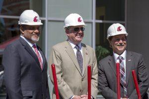 Wright, Schulz and Schoesler, in hard hats, with shovels, at groundbreaking.