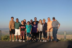 Group photo of about a dozen members of the Davis family, overlooking farm hills.
