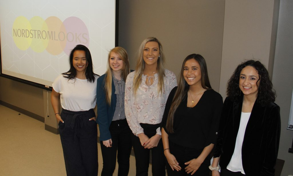 Five WSU students stand in front of a presentation screen.