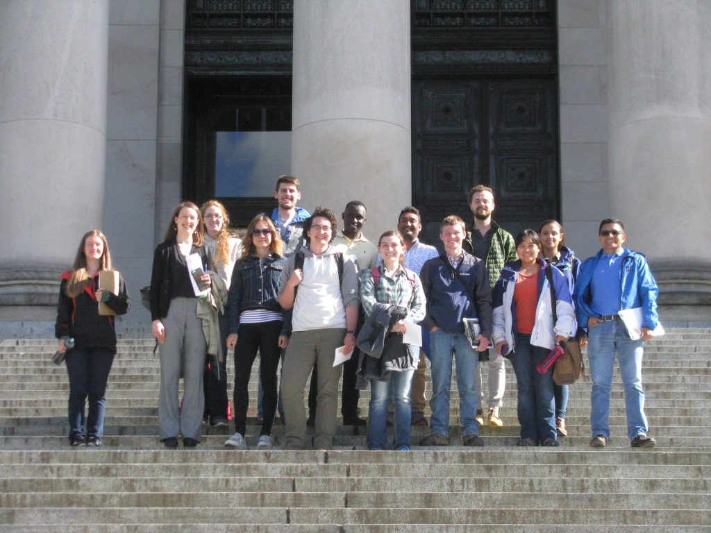 Gathering on the steps of the state Capitol dome, a group of WSU plant pathology students smile for the camera.