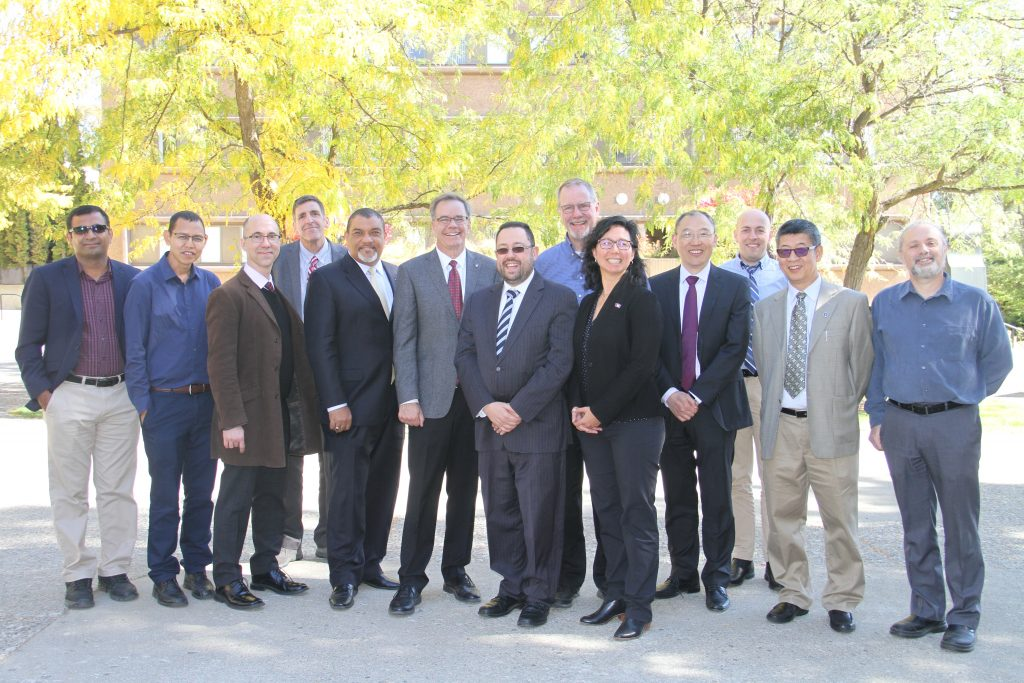 Group photo of WSU, CPAAS, UTS faculty in autumn setting