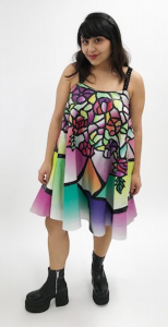 A model wears a colorful dress.