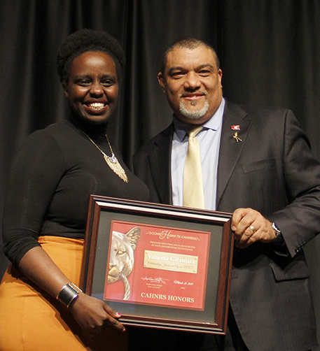 Giramata, left, with Dean Wright, holding framed award.