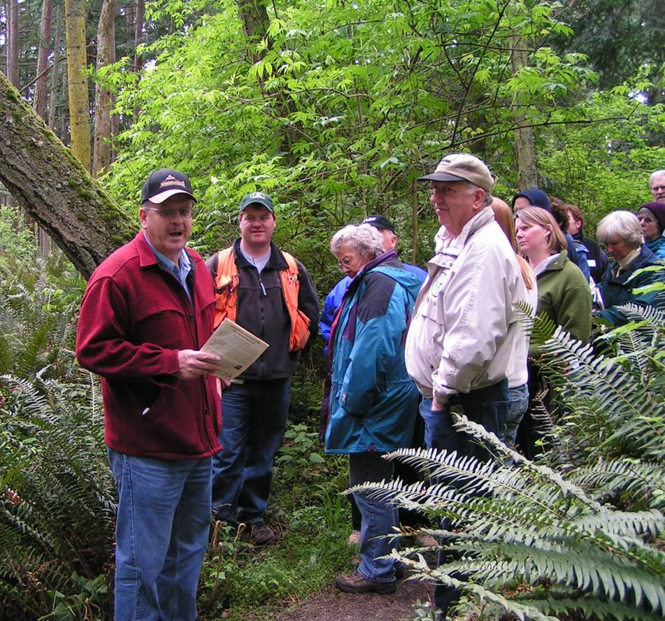 Hanley with tour group in a forest scene.