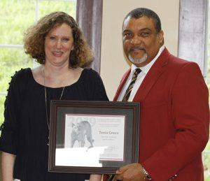 Green, left, accepts her award from the Dean.