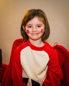 Young actor in apple costume