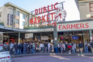 Multitude of people at the entrance of the Public Market on Pike Place in Seattle.