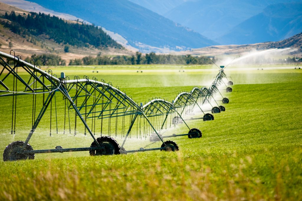 A large wheeled irrigation system in a field