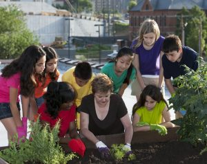 Urban garden with children and an adult